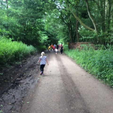 People running on the race course through Savernake Forest